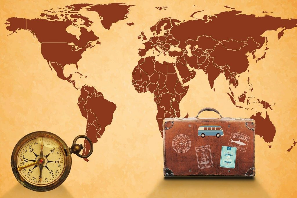 map of the world, compass, luggage